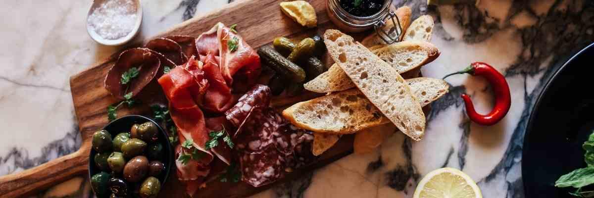 Mediterranean foods on a chopping board.